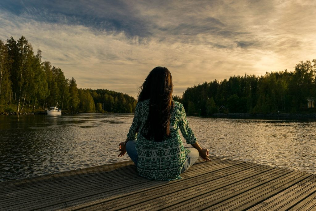 Young woman relaxing with meditation